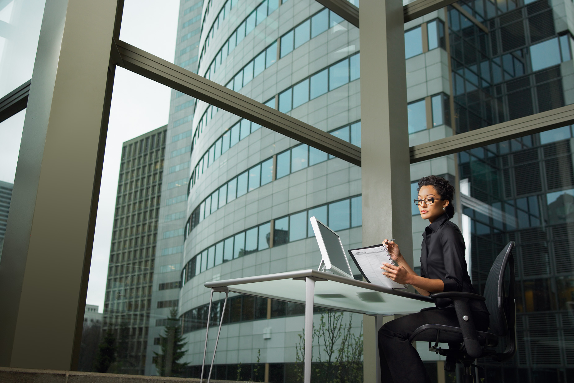 Atlanta businesswoman in modern office - Gregory Campbell