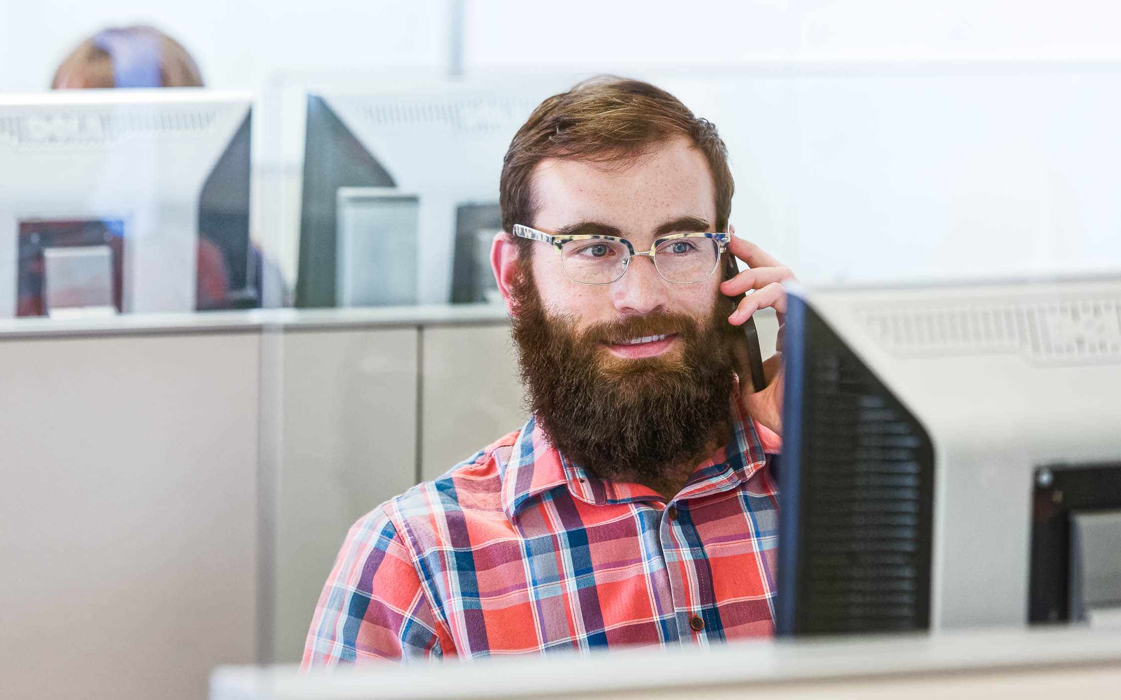 IT employee provides support on phone
