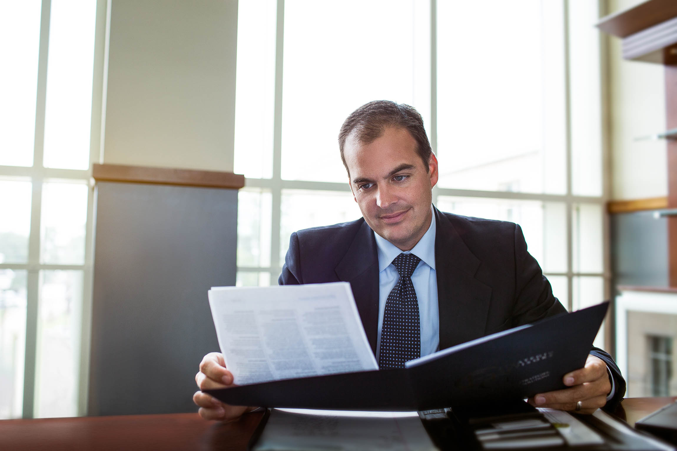 Atlanta Lawyer Reviewing a Document While Photographed