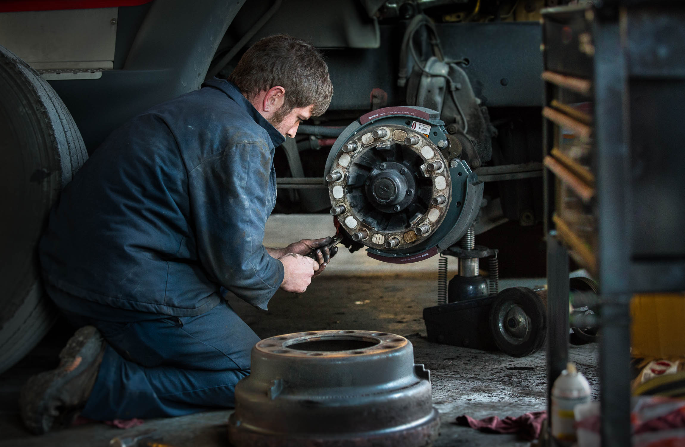 Truck mechanic in Atlanta installs brakes for photographer Gregory Campbell