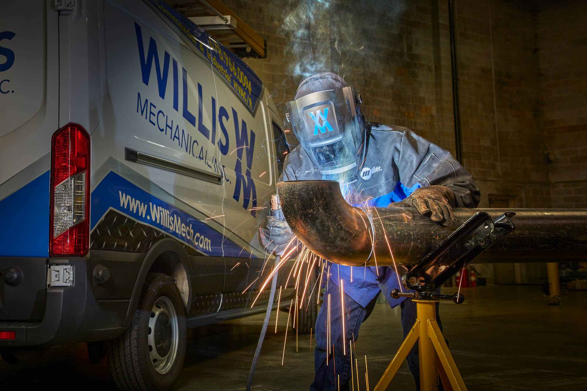 Photography of welder with sparks in Atlanta warehouse